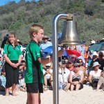 One of the school children from the Maheno School rings the ship's bell.